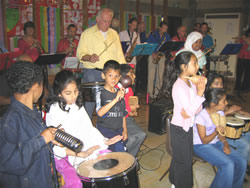 Photograph of the band with school children